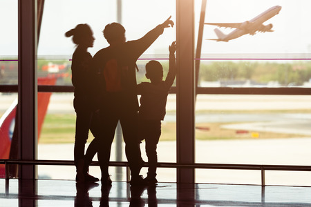 Photo for Silhouette of young family at airport - Royalty Free Image