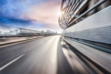Foto de Car driving on road in city background, motion blur - Imagen libre de derechos