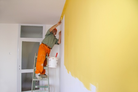 Painter in action, interior decoration