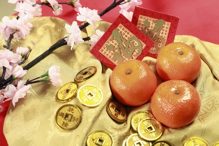 Antique chinese coins, plum blossom, red packets and mandarin oranges