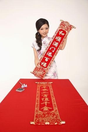 Woman holding banner with New Year's greeting