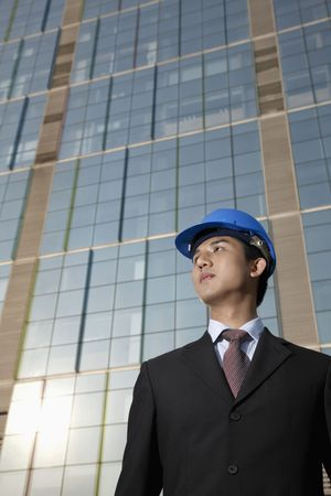 Businessman with safety helmet