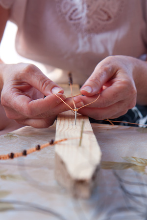 Young woman and folk handicraft