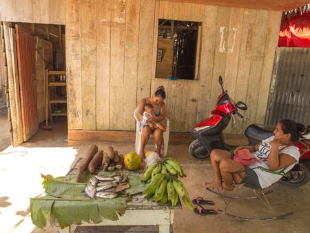 Santo Tomas, Peru - May 17, 2016: Peruvian women and child in the small village near  the Iquitos.