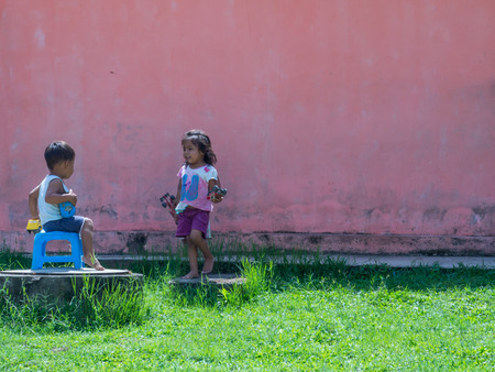 Santo Tomas, Peru - May 17, 2016: Peruvian  children in the small village near  the Iquitos.