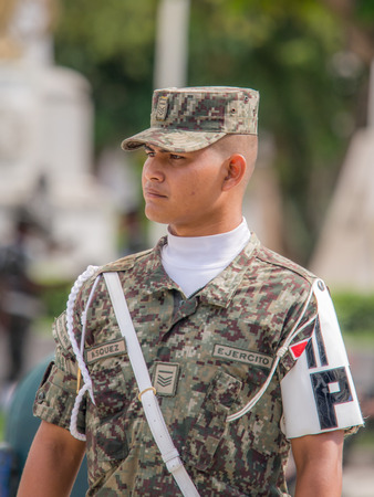 Iquitos, Peru - May 15, 2015: Peruvian soldier on Sunday morning  on the Plaza de Armas (Main square) in Iquitos.