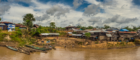 Amazon River, Peru - December 04 , 2018:  Panoramic view of village on the bank of the Amazon River. South America.