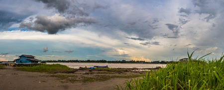 Amazon River, Peru - December 04 , 2018:  Panoramic view of wooden house on the bank of the Amazon River. Santa Rosa. South America.