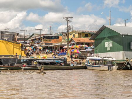 Benjamin Constant, Brazil - May 10, 2016: Floating houses on Amazon River. Amazonia. South America