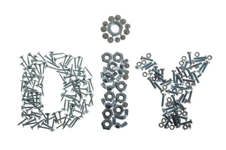 DIY label spelled out with screws, bolts and nuts isolated on white background