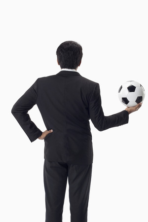 Soccer manager holding a ball