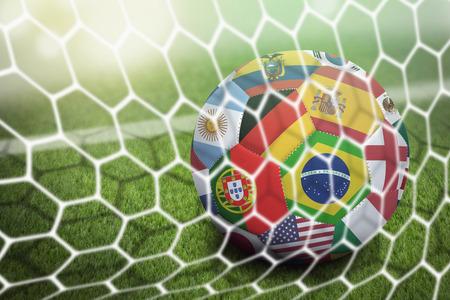 Photo pour World flags soccer ball in goal net - image libre de droit