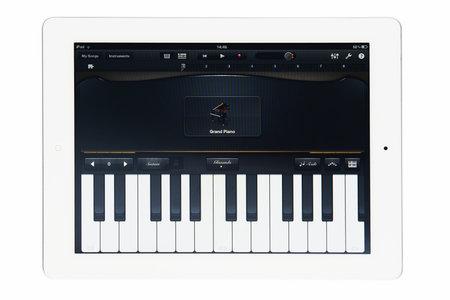 Apple iPad 2 with GarageBand music software isolated on white studio shot