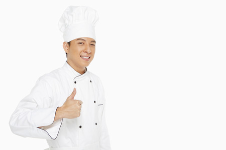 Cheerful chef showing hand gestureの写真素材