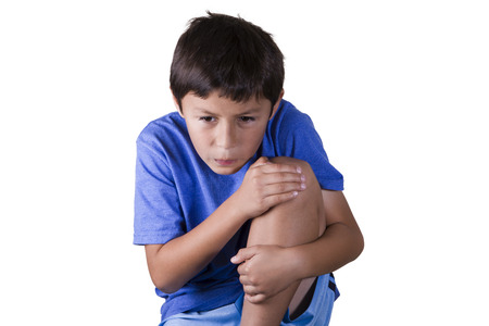 Young boy with hurt sprained knee