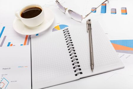 Photo for Notepad, a pen, coffee and glasses in business or school concept. - Royalty Free Image