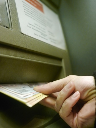 Finger using automatic teller keypad to enter pin number