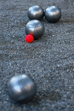 silver boccia ball on the ground