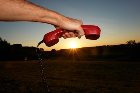 red phone in landscape