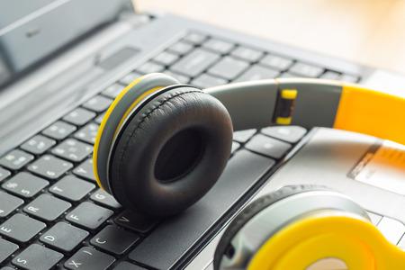 Headphone and Laptop. Enjoys digital music