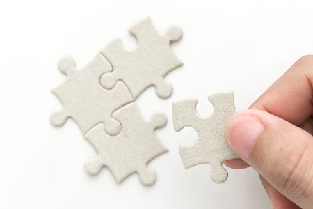 man hand holding last puzzle
