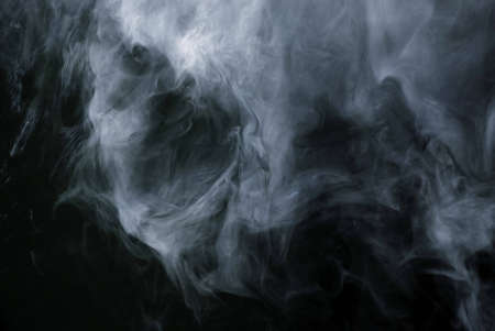 Appearance of cigarette smoke forming the shape of a skull.  Good for stop smoking ad, campaign, pamphlet, brochure or advertisement. Dry ice carbon dioxide gasses forming an image of a scary skull.