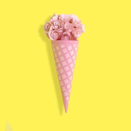 Foto de Paper waffle cone with flowers. Elegant voluminous paper decorations for birthday, anniversary, wedding. Paper art and craft. Trendy hobby. Minimal decorative holiday concept - Imagen libre de derechos