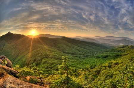 Photo for Fish-eye view of majestic sunset of the Russian Primorye mountains landscape HDR image  - Royalty Free Image