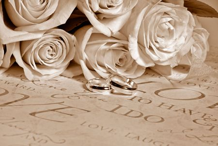 Bridal wedding bouquet with rings in sepia tones.
