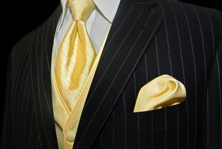 Gold necktie with pinstriped tuxedo.