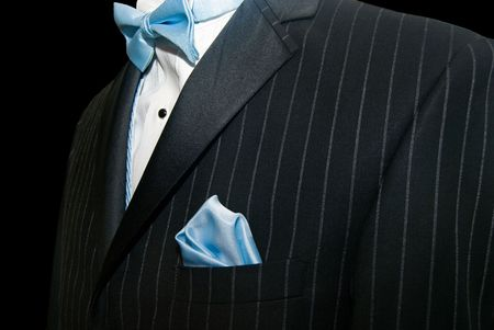 Blue bow tie with pinstriped tuxedo.