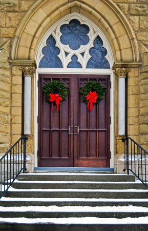 Christmas wreaths on cathedral doors.