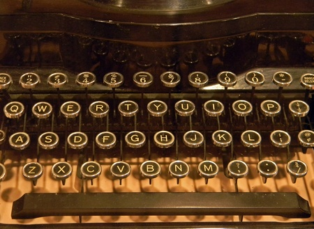 Close of old-fashioned typewriter in sepia tones.