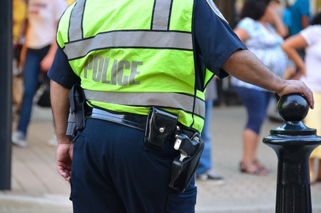 Photo for police officer wearing a neon vest - Royalty Free Image