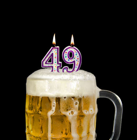 Photo pour number 49 candle in beer mug for birthday celebration isolated on black - image libre de droit