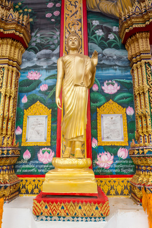 Standing statue of Buddha in Phuket, Thailand  Vertical composition