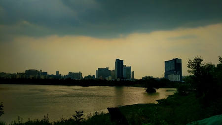 The evening view of the Xin Wei River and building
