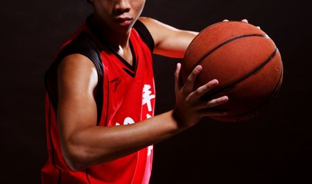 A young basketball player in red jersey