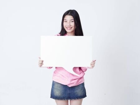 Photo for Portrait of teenage girl showing placard empty isolated on white background. - Royalty Free Image