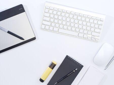 Foto für Office desk with keyboard, mouse, smartphone, notebook on white background. Working from home. - Lizenzfreies Bild