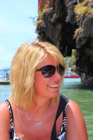 a blond mature woman wearing sunglasses