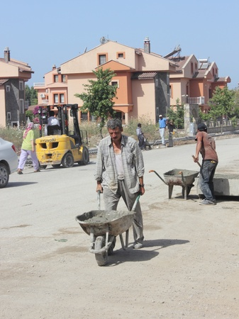 Turkish workmen repairing the roads and pavements,Turkey,calis,31st may 2013