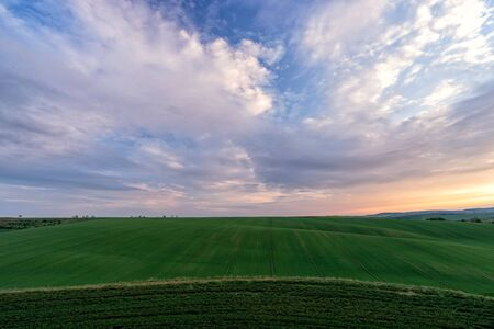 Photo pour Scenic view of beautiful country landscape. Clouds passing above rural fields in South Moravia, Czech Republic. - image libre de droit