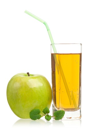 Fresh apple juice in the glass isolated on a white background close-upの写真素材