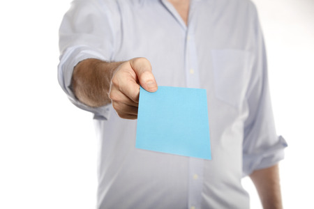 Man holds a blue letter with termination
