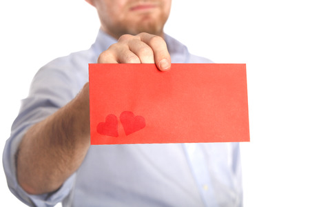Man holds a red love letter