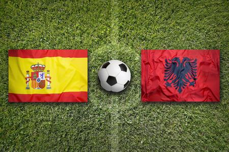Spain vs. Albania flags on a green soccer field