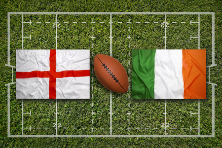 England vs. Ireland flags on green rugby field