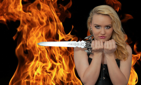 Attractive blond woman with sword