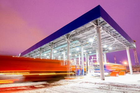 Photo pour gas station for trucks at oil refinery factory night time - image libre de droit